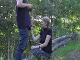 Slutty amateur chick favours a guy by sucking his dick outdoor