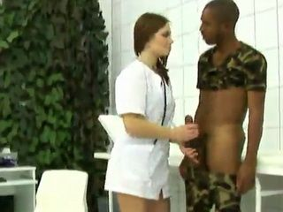 Juliya Sunrise is a sexy nurse whos giving a physical to a black