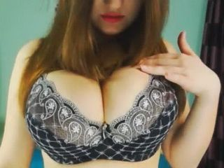 Brunette Showing Enormously Big Boobs