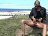 Blonde Pissing At The Beach