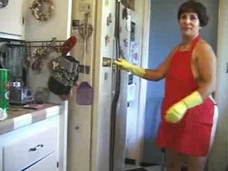 Stacy plays with stuff in the kitchen (www.OlderWomenVideos.com)