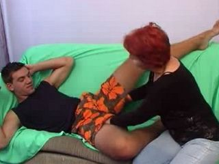 Mature Mom Gives Special Dick Massage To Younger Man On The Sofa