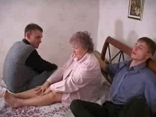 Russian Granny Gets Gangbanged by Two Much Younger Guys in her bedroom