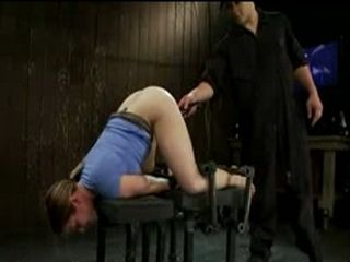 Bound brunette spanked and toyed from behind