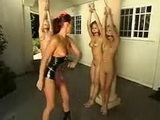 Mistress flogs three bound girls outdoor