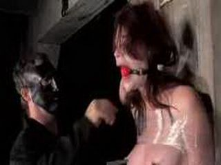 Babe tied in cellophane gets flogged by two guys