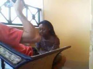 Petite African hooker gives interracial blowjob in a balcony