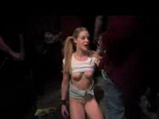 Bound blonde babe gives blowjobs in orgy