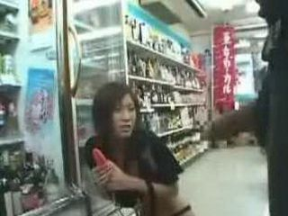 Asian beautiful woman in plays in the convenience store