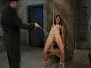 Hogtied brunette gets whipped in dungeon