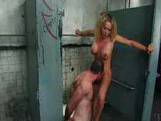 Busty tranny jerks dick to bound guy in restroom