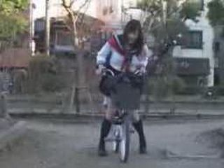 Crazy Girl Ridding A Bicycle With Vibrator On The Seat Through The City
