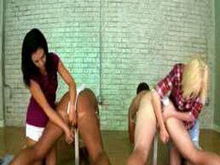 Girls milking two guys