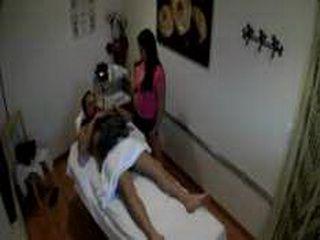 Asian masseuse rubs a guys cock