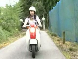 Guy Shakes Japanese Girl's Boobs While They're Driving On The Bike