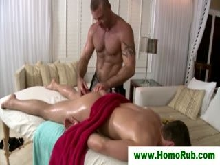 Muscular masseur gives straight guy cock massage