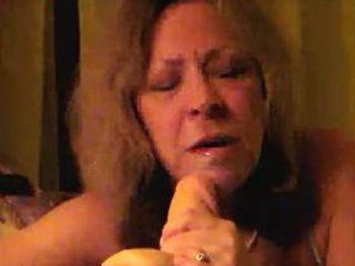 Horny mature wife sucks a squirting dildo slowly