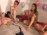 Lesbian amateurs have fun with a strapon at sex dare party