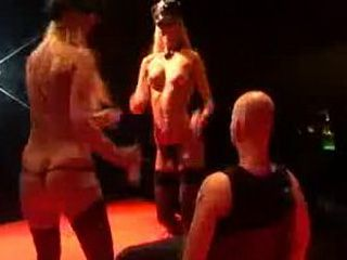 Two strippers dildo on stage
