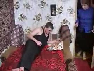 Russian Granny Catches Guy Masturbating On Porn Magazine