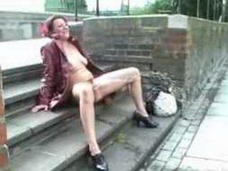 Mature Lady Masturbate and Piss on the Street