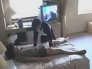 Cute Japanese hotel busgirl gives cock massage.