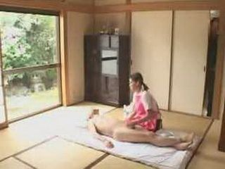 Japanese caregiver gives handjob and more