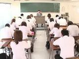 Japanese couple fucks in the middle of a school classroom