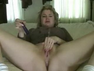 Horny MILF toying her wet pussy on cam