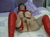 Vickie cumming in red on the bed (www.eroslane.com)