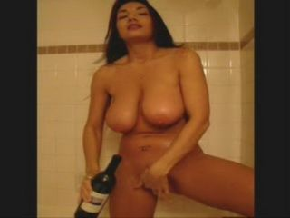 Gorgeous Babe Making A Video Tape For Her BF On A Valentines Day With A Wine Bottle