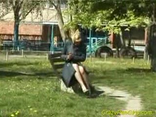 Blonde pees in park