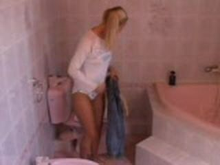 Blond Teen With Pony Tails Masturbate And Piss In Bath