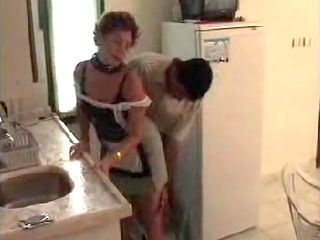 Guy Fucks Mature Maid In Kitchen