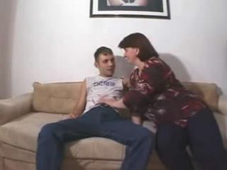 Horny teen boy slams his moms juicy squelching snatch on the sofa
