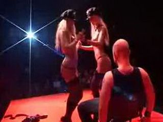 Two strippers dildoing pussy
