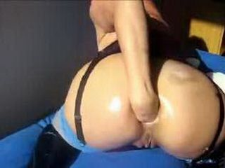 Horny babe fisting her own asshole on webcam
