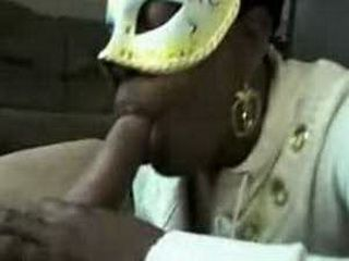 Black babe with mask sucks cock and swallows