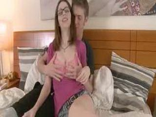 Lovely teen in glasses licked and done on bed