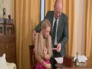 Teacher enjoying his blonde teen student
