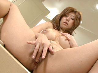 Naho Hadsuki hands roaming and fingering hairy pussy on the toilet