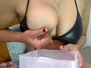 Lactating asian babe plays with her tits