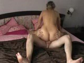 Sexy MILF wearing boots and rides hubby