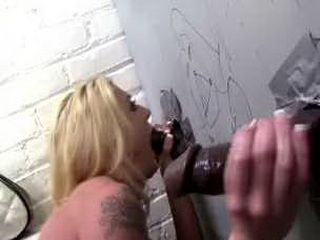 Gorgeous busty blonde Leya Falcon is fucked doggystyle through a gloryhole