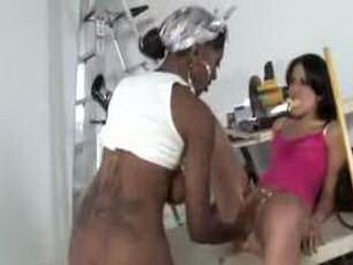 Busty black woman dominates brunette girl with big ass