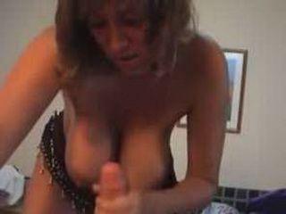 MILF with big breasts gives nice handjob