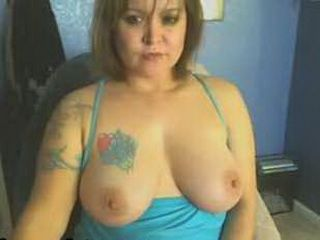 Busty MILF with tattoos dildoing her pussy