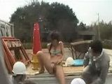 Micro bikini clad Japan beauty masturbates in public