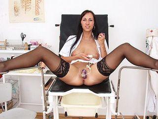 Naughty leggy nurse Nikki plays with clit pump