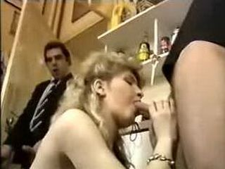 Blond slut takes two in the kitchen